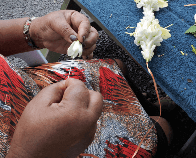 Woman Making Flower Necklace